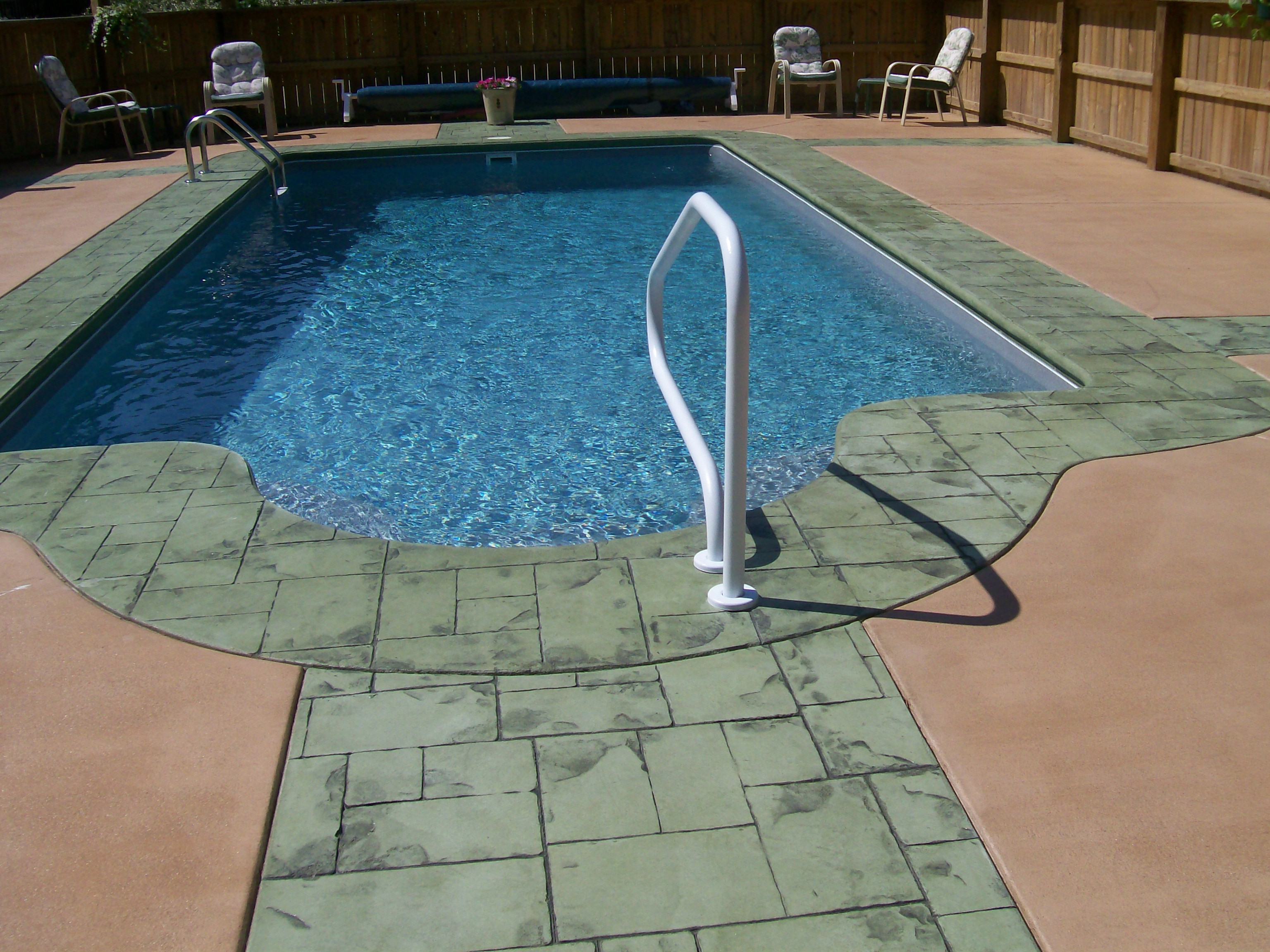 Colored Concrete Pool Deck Concrete Stamped Border Driveway With Broom Finish Interior.